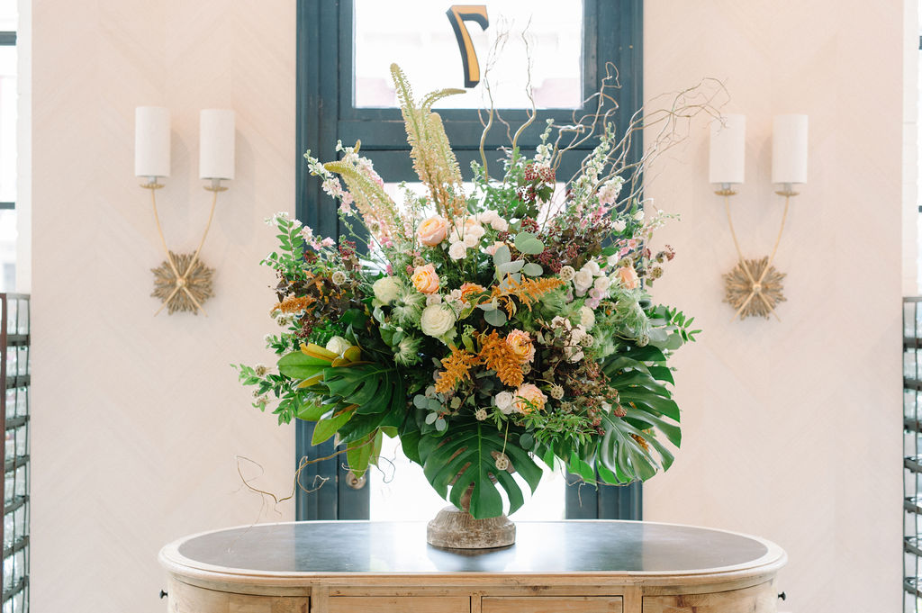 A beautiful floral arrangement on entrance table at The Patton Room