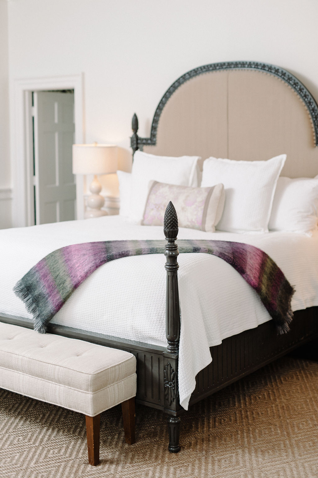 Colorful ombre throw over four post bed in Room 2