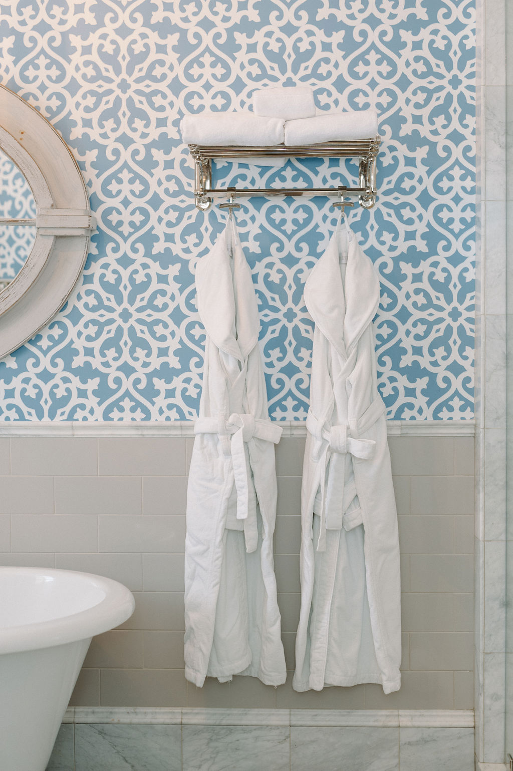 Two robes hanging on wall in bathroom of Room 4