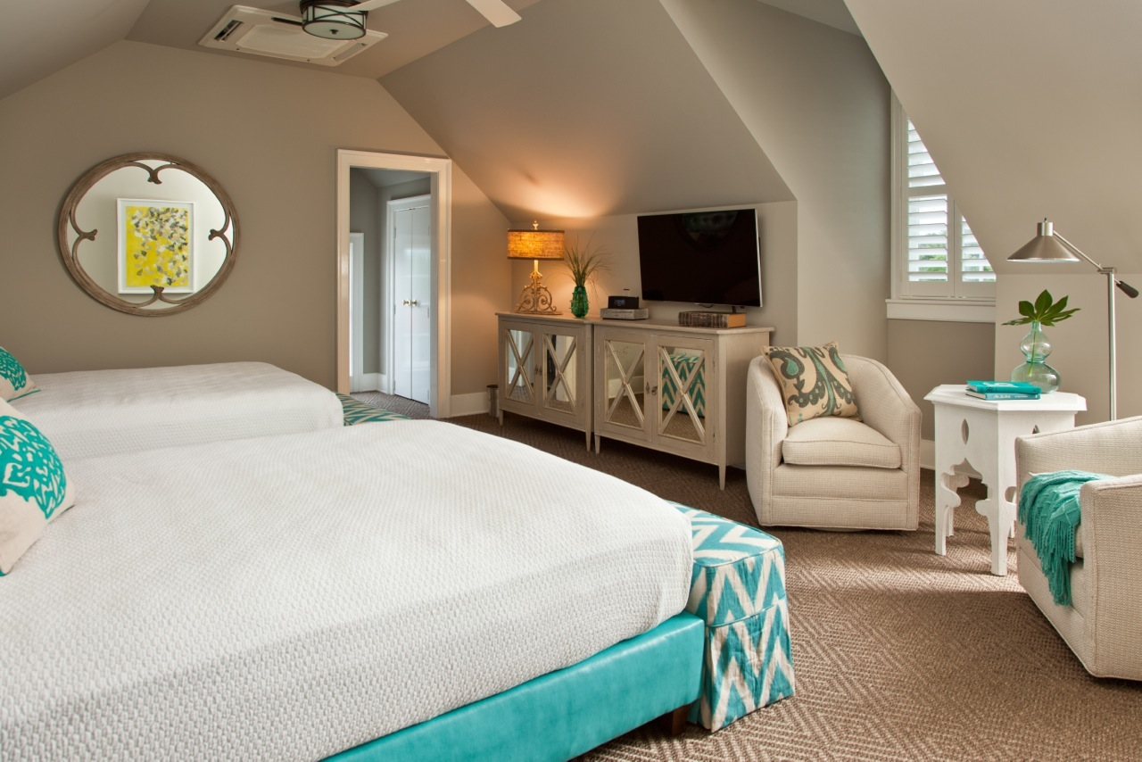 View of two queen beds and flat screen TV in Room 18