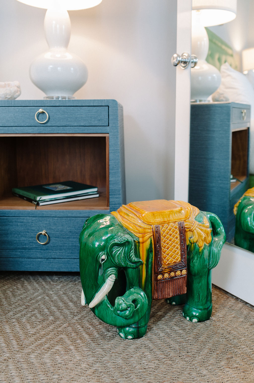 Detail of green elephant sculpture next to nightstand in Room 11