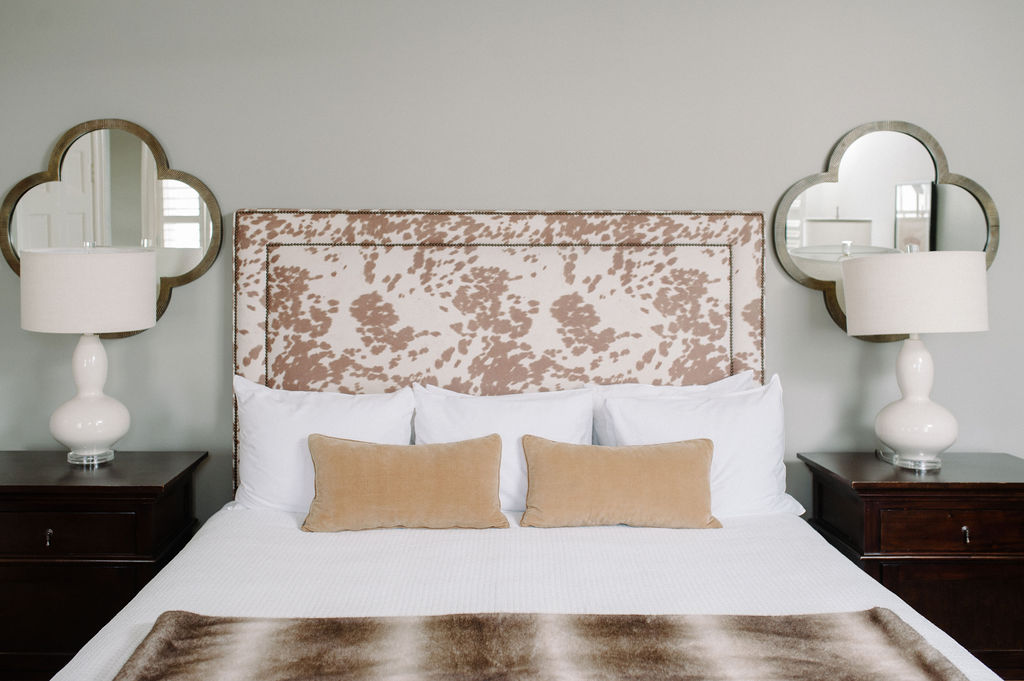 Headboard with cow print in Room 14