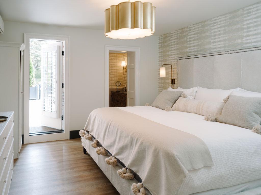 Bed with view of patio door, room 20