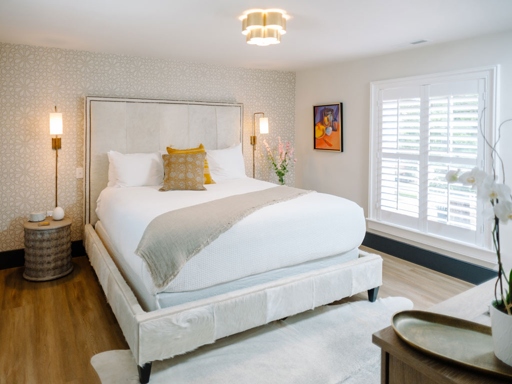 Airy bedroom with large windows
